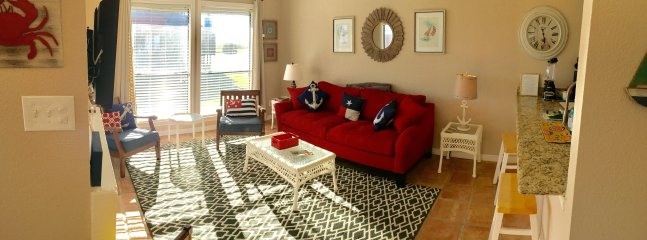 spacious living room with couch, 3 chairs & bar-stools-room enough for everyone!