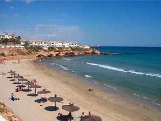 Villamartin holiday villa rental with shared pool, beach nearby, balcony&terrace