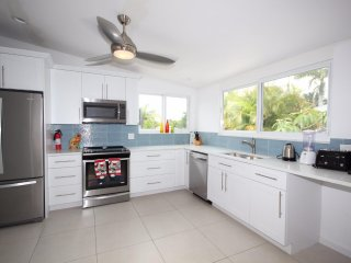 Large modern kitchen with all new appliances and granite countertops