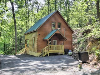 The rustic cabin for 8 is tucked away in the hills on a peaceful pond.