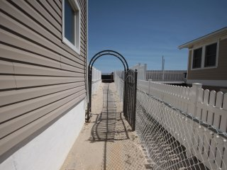walkway from  house leading to the beach and boardwalk!