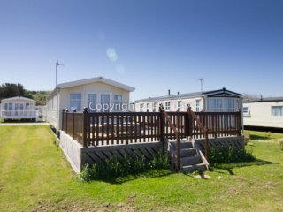 Ref 20276 8 berth caravan  a full seaview & large decking at Broadland sands.