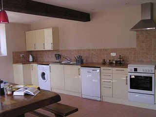 The spacious kitchen has everything you could need.