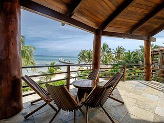 Designer Beach Villa steps from the Caribbean! Free Golf Cart*