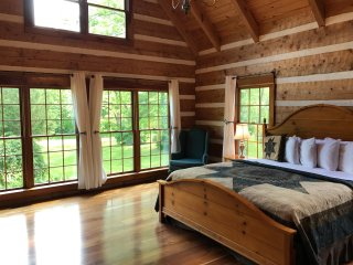 Master Bedroom with beautiful views and a clean luxurious king size bed.