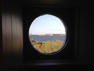 Bedroom 2 porthole looks out to Fort George across the Moray Firth