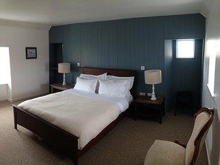 Triple aspect sea views in bedroom 1.