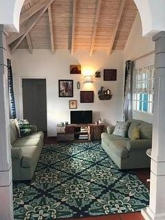 living room with cable TV