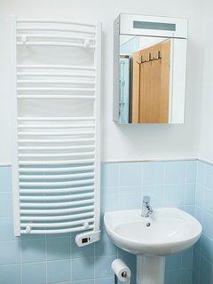 Bathroom mirror and towel rail area.