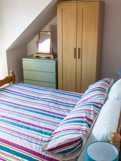 Second upstairs bedroom, light and airy, ample drawer and wardrobe space, tv.