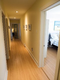 Guest House: down the hall are the laundry room, bathroom and the Sandy Hill Room. Lots of privacy!