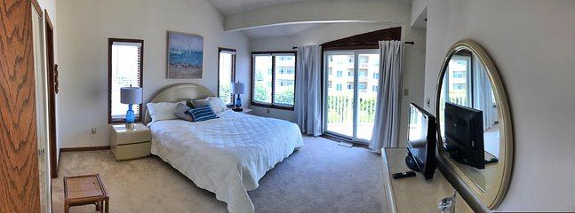 Master bedroom with ensuite bath with soaking tub. Ocean views with a glimpse of the bay from deck.