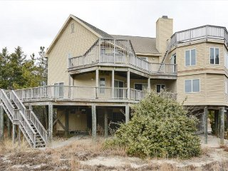 Lovely 6 bedroom home with excellent ocean views. Walk to the beach!