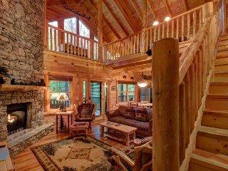 Secluded cabin near creek w/ hot tub, deck, game room & shared seasonal pool!