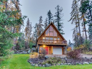Rustic charm w/ modern amenities, an expansive back patio, lake view!