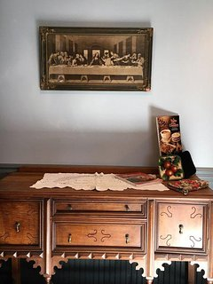 antique buffet and picture add to your ambience