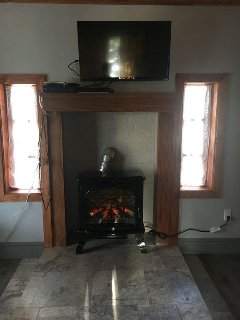 electric fireplace for ambience, TV with Direct TV connection