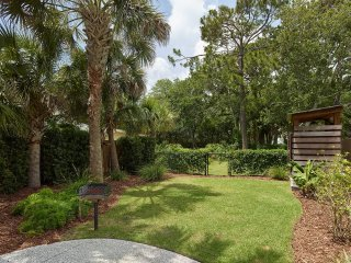 fenced yard with outdoor seating, grill and private outdoor shower
