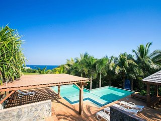Spectacular hilltop home with Caribbean Sea views from every room!