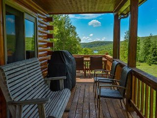 Log home with lake views with a boat slip, 5 minutes from Wisp!