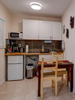 Fully equipped kitchenette with toaster, microwave, coffee maker and 2 burners