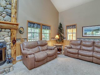Well-maintained home w/large dec, hot tub, & space for three snowmobile trailers