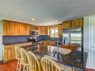 Updated kitchen including stainless appliances and granite counters.