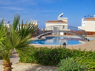 Gorgeous apartment in cyprus with sunny terrace, huge pool and sea views
