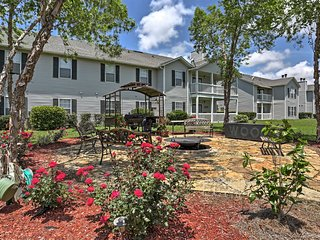 The beautifully landscaped fire pit area is the perfect place to relax after a long day of fun in Gulf Shores.