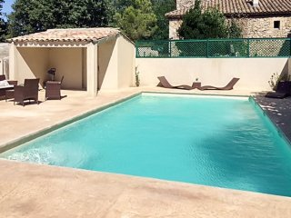 Stone house in Saint-Victor-la-Coste with a swimming pool!