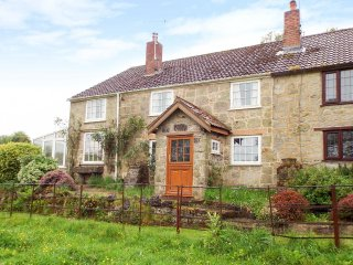 1 CASTLE ORCHARD, end-terrace stone cottage, WiFi, dog-friendly, lawned garden