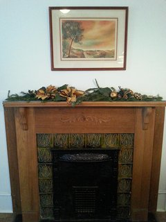 Kitchen fireplace (3 non-working fireplaces in apt) dressed for Christmas