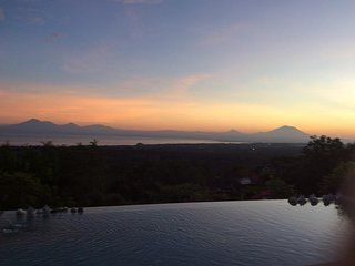 overlooking the sunrise and Agung Volcano from the swimming pool