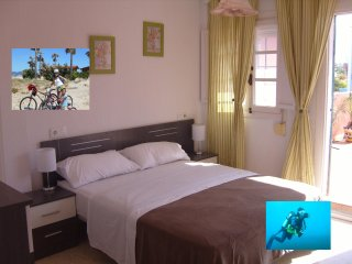 Holiday double bedroom with roomsbikeanddive