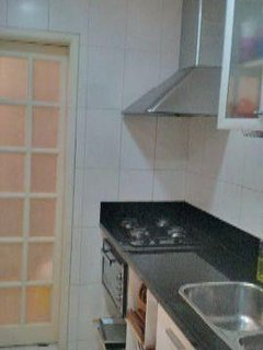 Kitchen has sliding door allowing for separation from dining area.