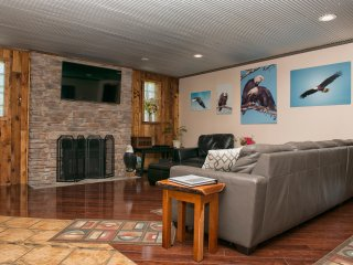 Living room with 55' Flat screen TV, cable, DVD player, leather furniture
