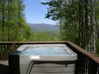 Hot tub with great mountain views for relaxing after a day of hiking.