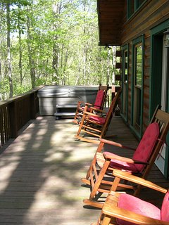 Four rocking chairs for relaxing, and taking in the sweet mountain air.
