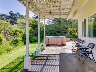 Dog-friendly home w/private hot tub, deck & firepit + only half a mile to beach