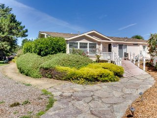 Dog-friendly home in coastal dunes w/ private hot tub, fenced yard, ocean views!