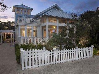 High-end cottage w/ wraparound decks, a shared pool, walk to the beach!