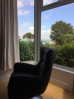 Swivel chair in bay window with sea views