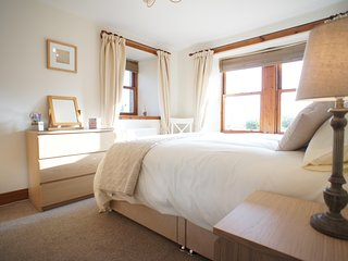 One double bedroom with quality bed linen and towels provided. Travel cot available on request.