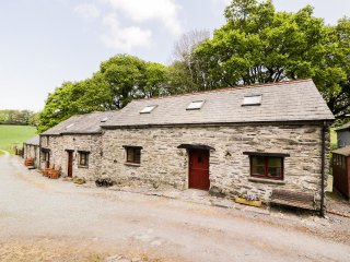 YSGUBOR COTTAGE, stone cottage, slate floors, exposed beams, shared patio, prett