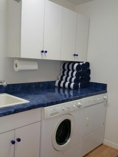 Laundry room with large load capacity, plus there is a second laundry area.