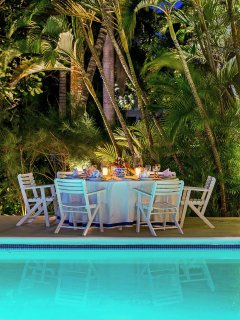 Candlelight dinners are served on the covered verandah, barefoot on the beach, or most often poolside ...
