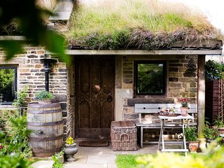 The Smithy is a stone detached cottage with a grass and heather roof