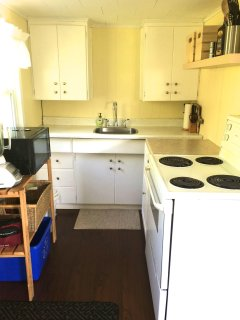 Kitchen supplied with dishes, pots, pans, small appliances, full fridge & stove, spices, tea, coffee