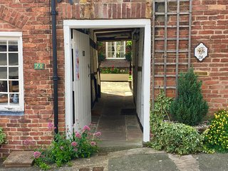 The passageway leads to three properties - the front door to ours is on the right hand side.