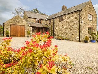 COED Y GAER, detached stone farmhouse, open fire, WiFi, games room, near